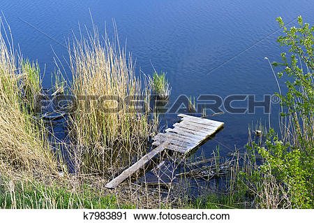Stock Photography of wooden platform on the river k7983891.