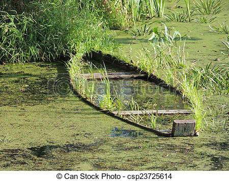 Stock Photography of waterlogged wooden boat.
