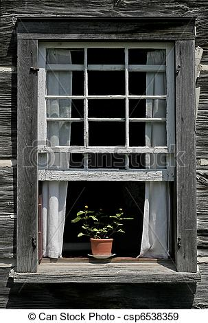 Stock Photographs of A flower pot on old Window Sill.