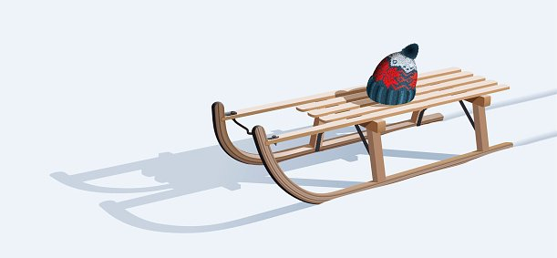 Wooden sled and hat on snow Clipart Image.