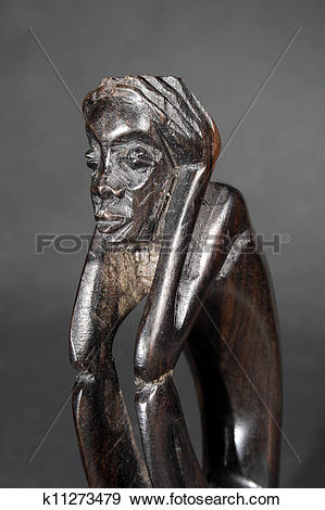 Stock Photograph of African handmade wood statue k11273479.