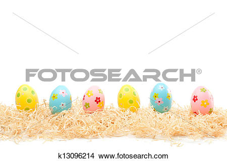 Stock Photo of Sweet Easter Eggs on Wood Wool k13096214.