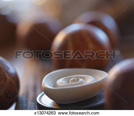 Stock Photo of Incense oil stone with decorative wooden balls.