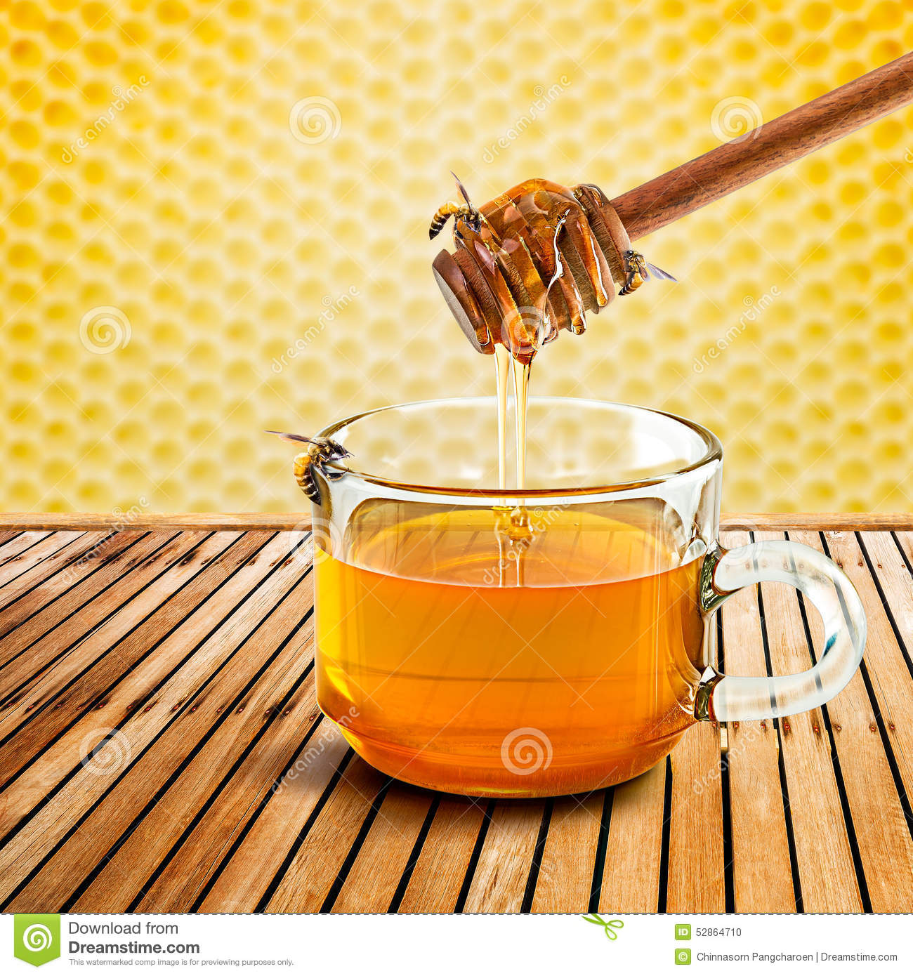 Honey Dipper And Bee Stock Photo.