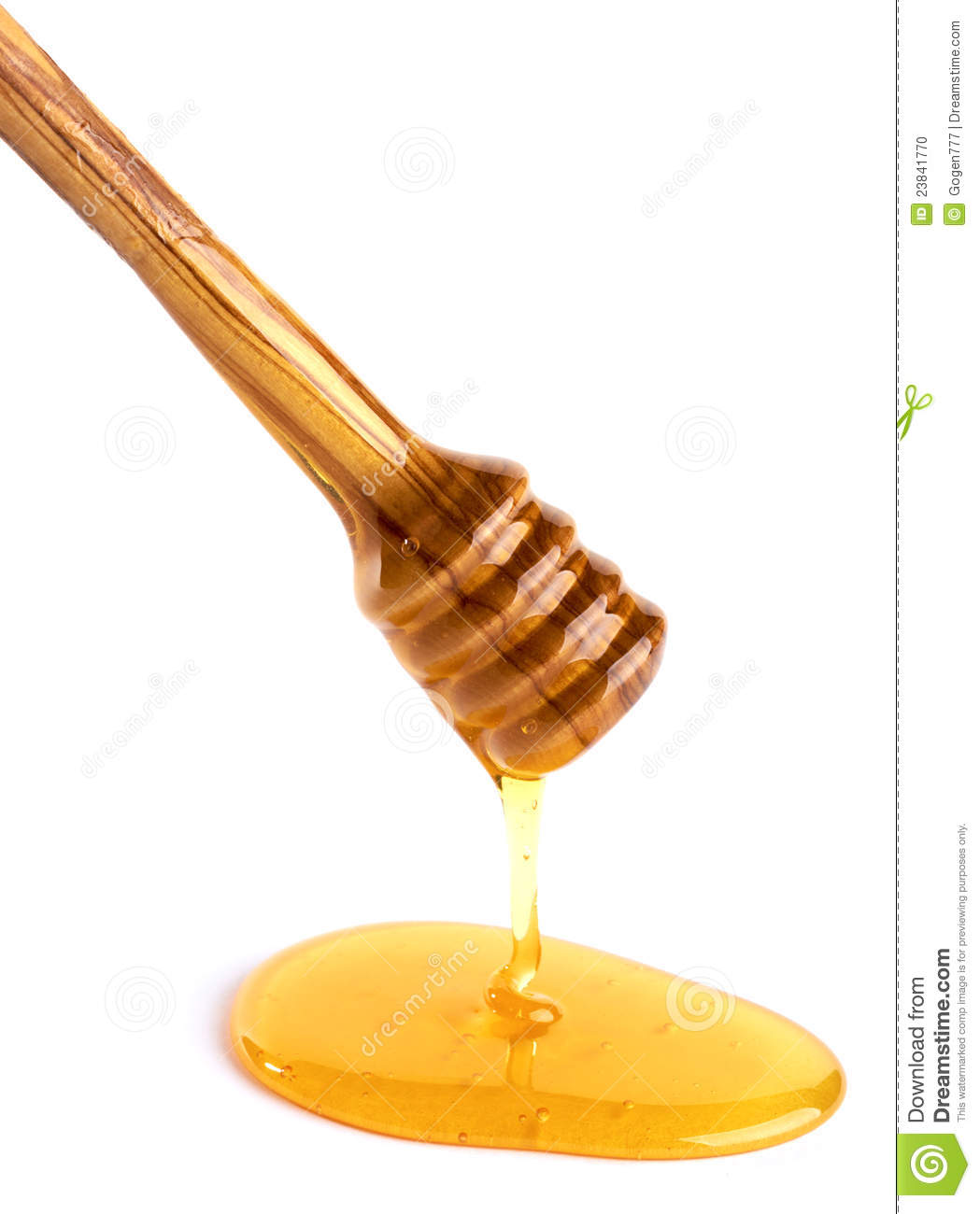 Honey Flowing Down From A Wooden Honey Dipper Stock Photo.