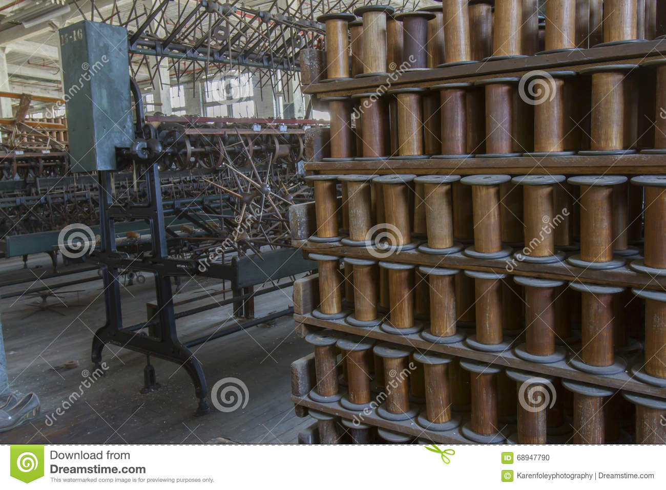 Thread Factory Floor With Wooden Bobbins Stock Photo.