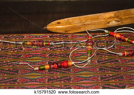 Stock Photography of Spool of thread and wooden bobbin ,thai.