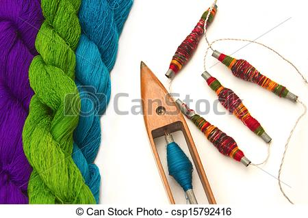 Stock Photography of Spool of thread and wooden bobbin with raw.