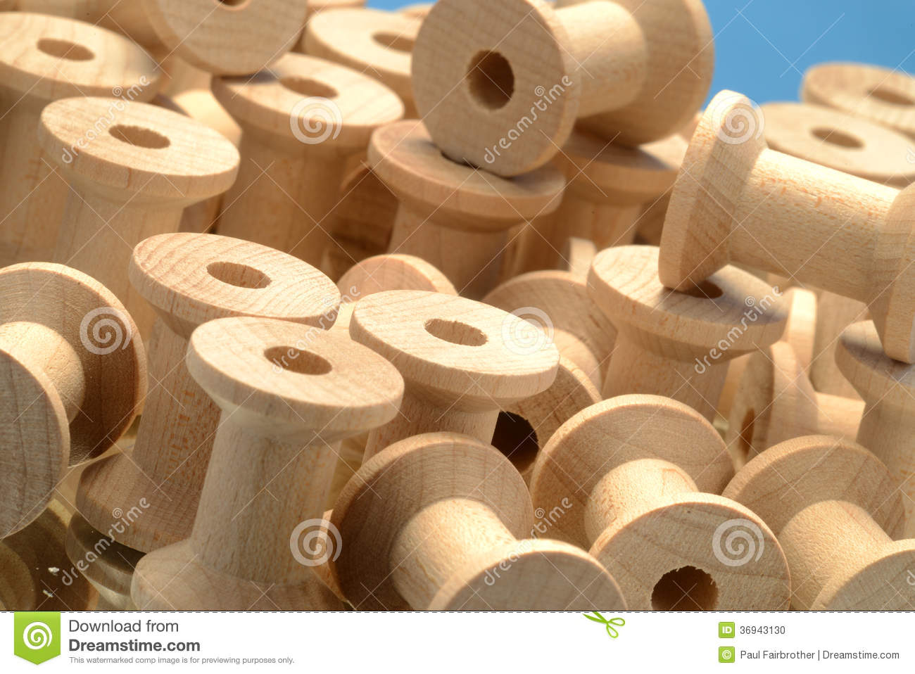 Pile Of Wooden Bobbins Stock Photo.