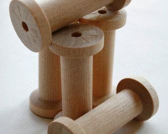 Wooden bobbins.