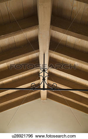 Stock Images of Wrought iron beam supporting wooden ceiling.