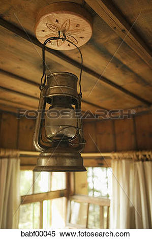 Stock Image of Oil lamp hanging on wooden ceiling babf00045.