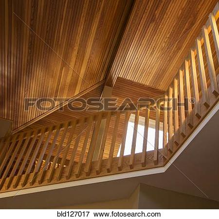 Picture of Slanted wooden ceiling above railing in house bld127017.