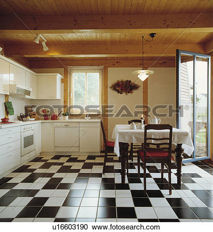 Stock Photography of Wooden ceiling and black+white ceramic tiles.