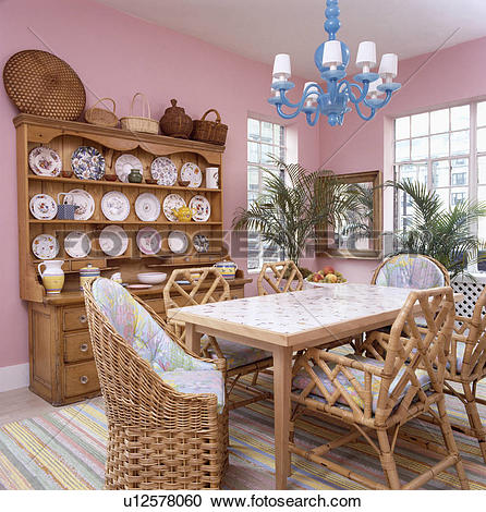 Stock Photography of Blue wood chandelier above table with wicker.