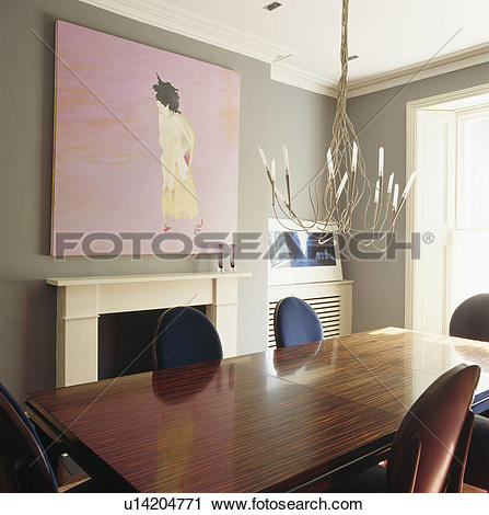 Stock Photography of Large modern picture above fireplace in.