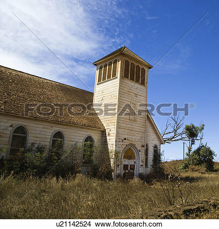 Stock Photo of Old abandoned white wooden church in Maui, Hawaii.