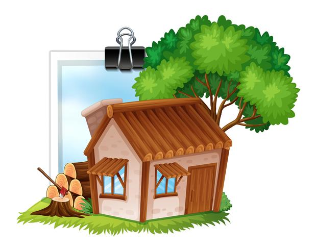 Wooden cottage on photoframe.