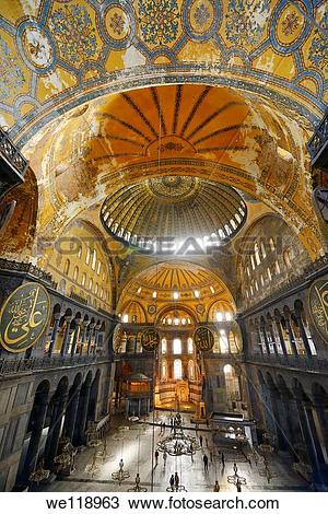 Stock Photo of Golden domes frescoe and crooked Qiblah wall inside.