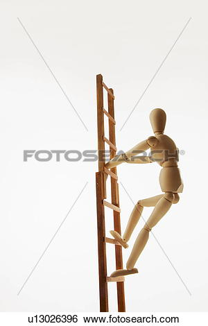 Stock Images of Wooden figure climbing ladder, white background.