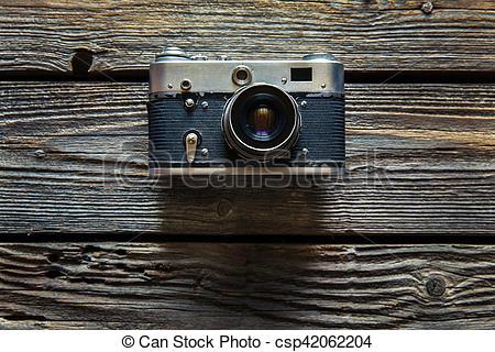 Vintage camera on wooden background.