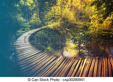 Stock Photo of Wooden path and waterfall in Plitvice National Park.