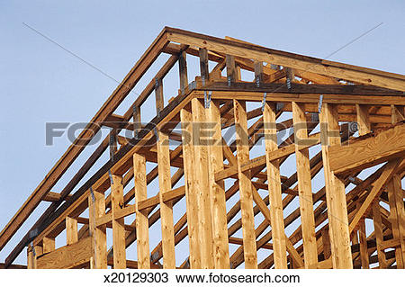Stock Photo of Wooden roof frame and wall x20129303.