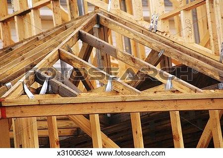 Stock Photo of Wooden roof frame with metal supports x31006324.
