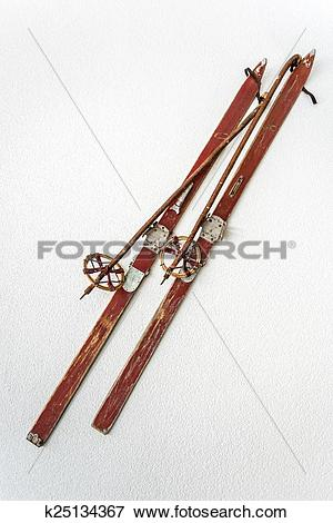 Picture of old wooden skis on white background k25134367.