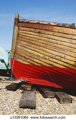 Stock Photo of Close up of wooden boat with red painted keel on.
