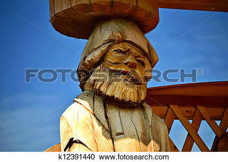 Stock Photography of Carved wooden statue adult man k12391440.
