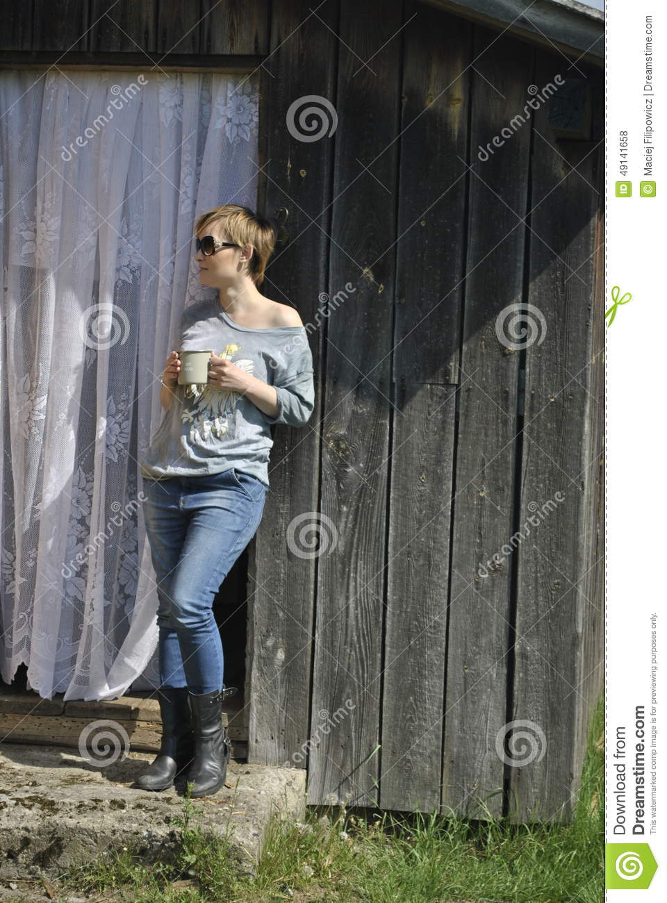 Young Short Hair Woman Standing On The Threshold Of A House Stock.