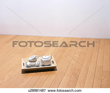 Picture of Cups, saucers and a pot kept in a wooden tray u28981487.