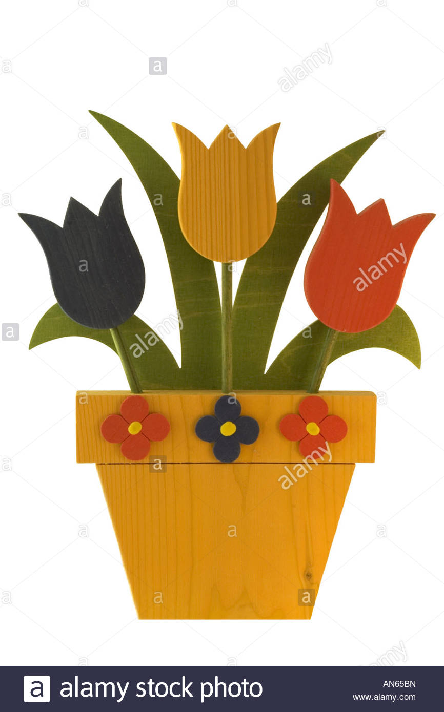 Three Wooden Tulips In Wooden Pot Stock Photo, Royalty Free Image.