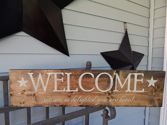 Wood, painted Welcome sign with star clipart Welcome we are so delighted  you are here!.