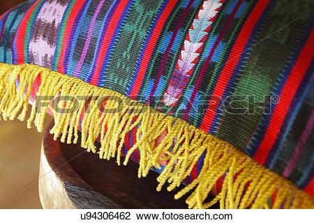 Stock Photo of Detail fringe on corner of decorative pillow, Ojo.