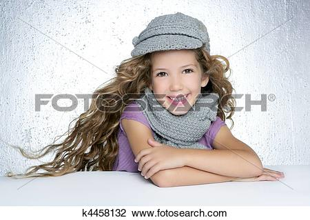 Stock Photo of winter cap wool scarf litle fashion girl wind on.