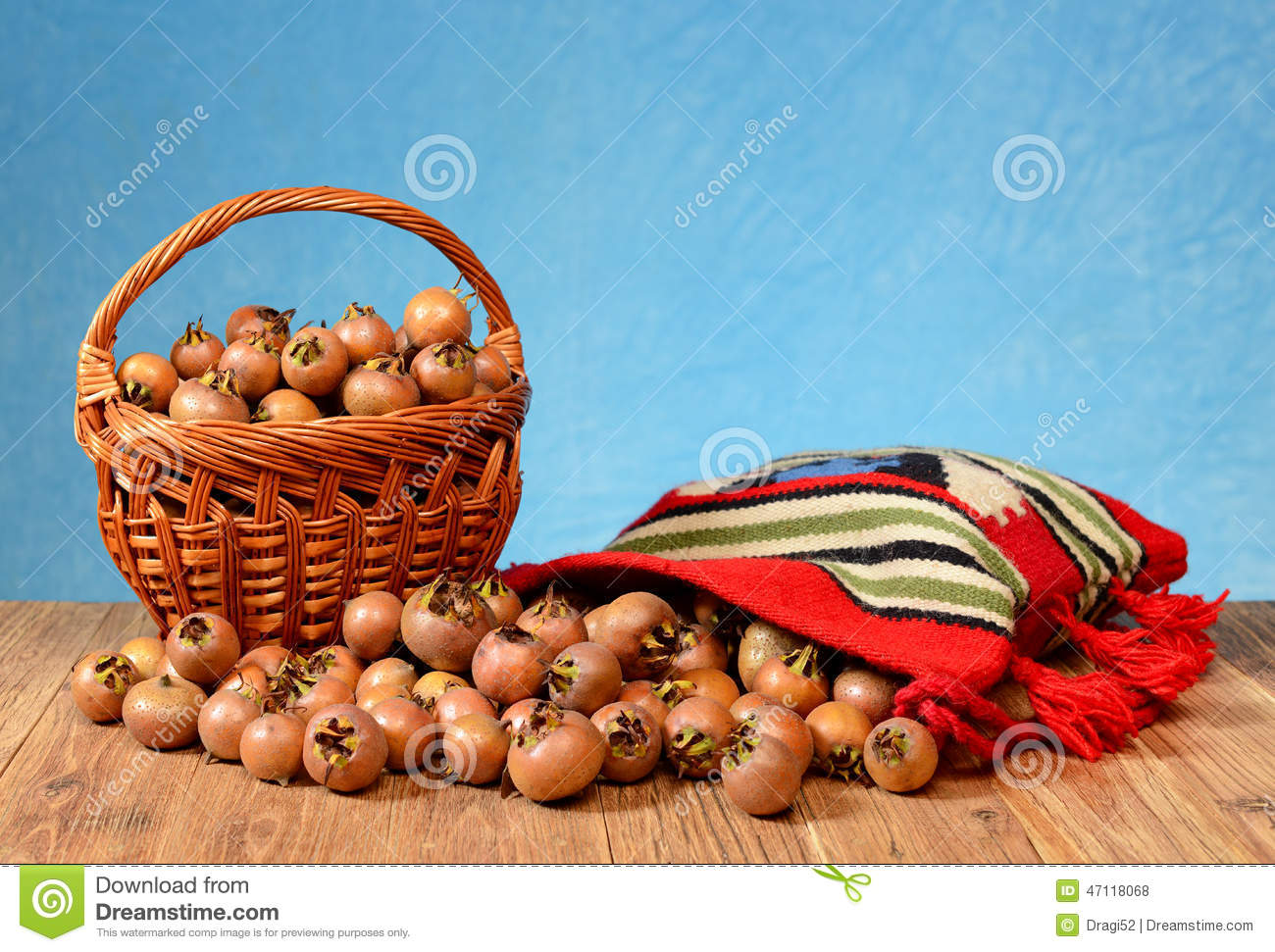 Medlar In A Wicker Basket And In A Etno Bag Stock Photo.