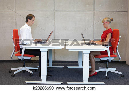Stock Photography of professionals at work stations k23286590.