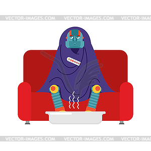 Robot sick sitting in armchair wrapped in blanket..