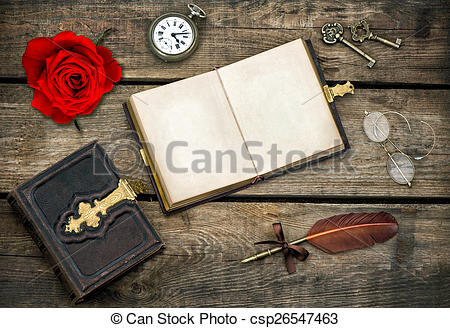 Stock Image of antique books, writing accessories and red rose.