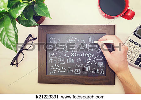 Clipart of Man drawing strategy cartoon on chalkboard k21223391.