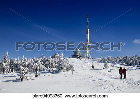 Stock Photography of Radio transmission tower and snow.