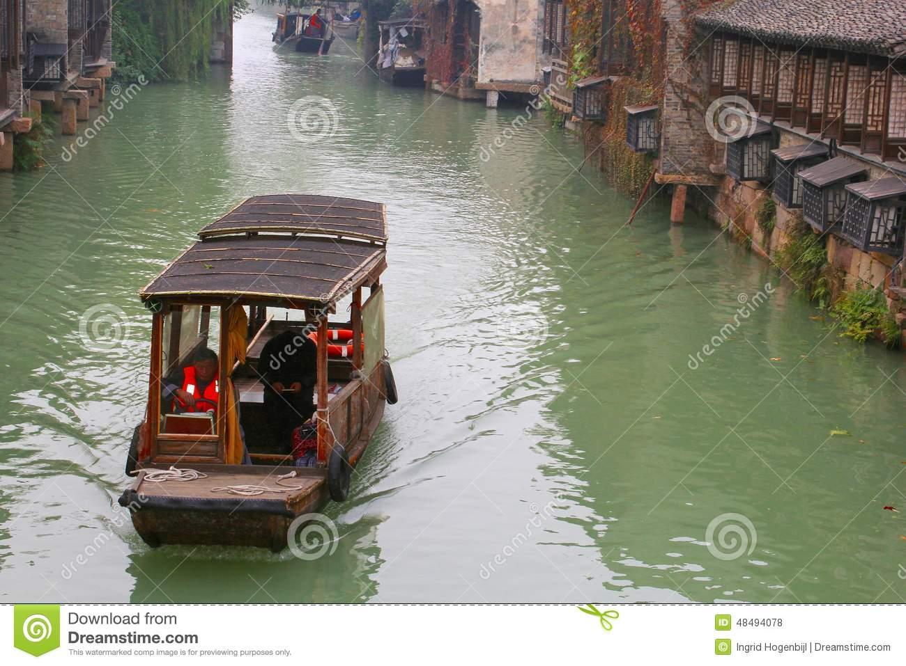 China ,wuzhen Water Village,People Row A Boat Editorial.