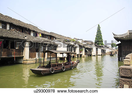 Pictures of Asia, China, Zhejiang Province, Wuzhen, Rowing boat in.