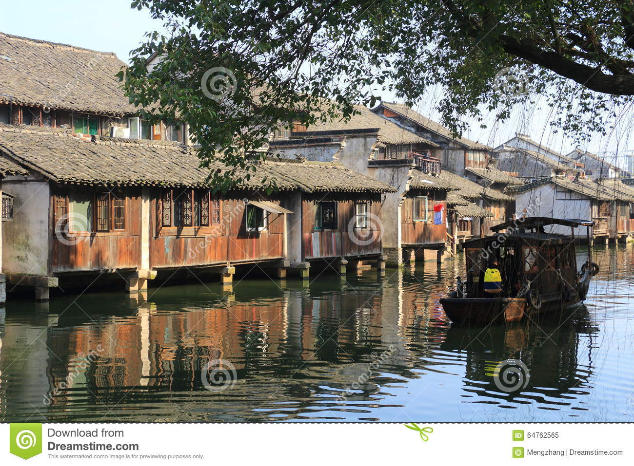 China ,wuzhen Water Village,People Row A Boat Editorial Image.