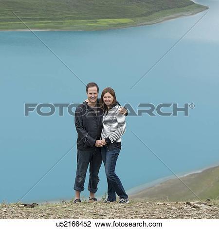 Stock Photo of Couple standing at Yamdrok Lake, Nagarze, Shannan.