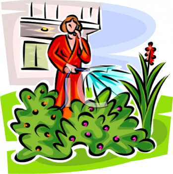 Woman Watering Her Yard Talking on a Cellphone.