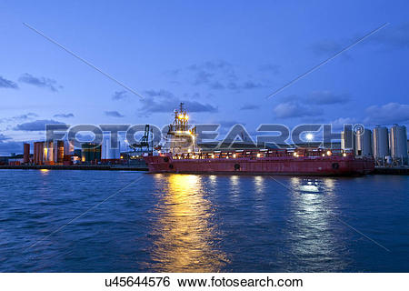 Stock Images of England, Norfolk, Great Yarmouth. A cargo ship in.