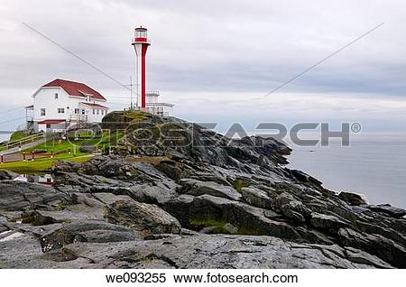 Stock Image of Cape Forchu lighthouse and wet rocks near Yarmouth.